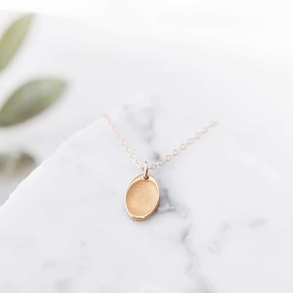 gold fingerprint pendant